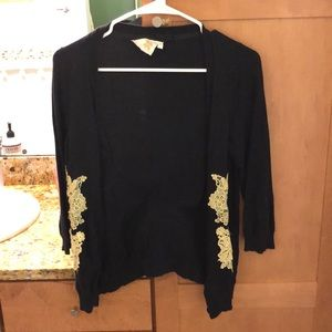 Black cardigan from Anthropologie with gold trim